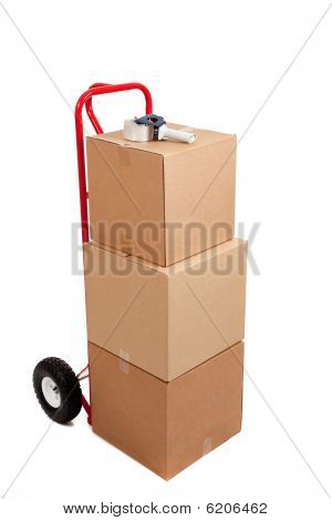 Cardboard Boxes On A Red Hand Truck