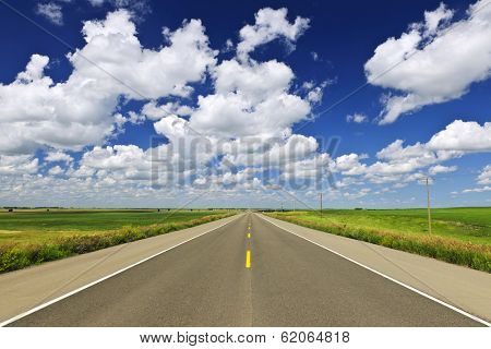 Long stretch of flat highway in Saskatchewan prairies, Canada