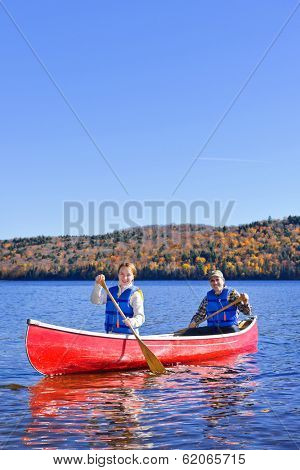 Family canoeing on Lake of Two Rivers, Ontario, Canada