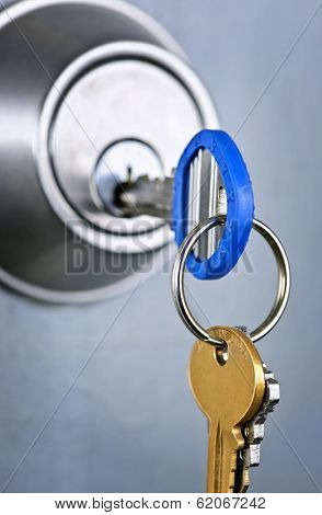 Keys inserted in door lock close up