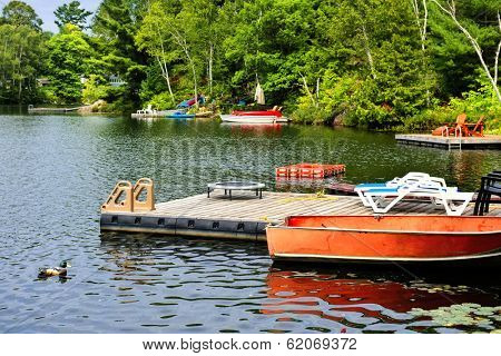Beautiful lake with docks and diving platform in Ontario Canada cottage country