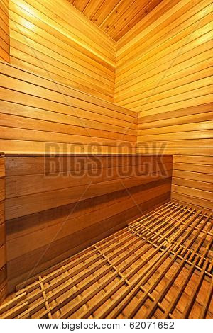 Finnish home sauna interior with wooden bench walls and floor