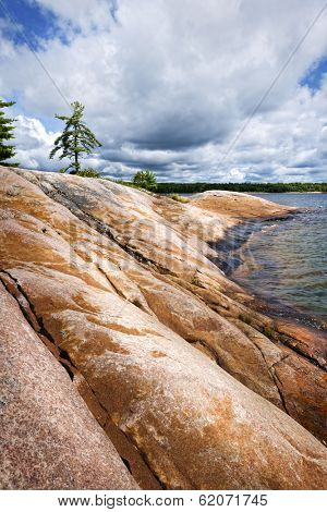Smooth rocky lake shore of Georgian Bay in Killbear provincial park near Parry Sound, Ontario, Canada.