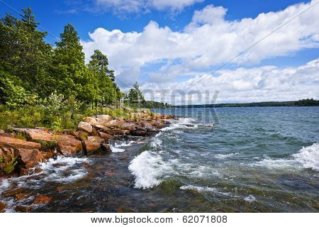Rocky lake shore of Georgian Bay in Killbear provincial park near Parry Sound, Ontario, Canada.