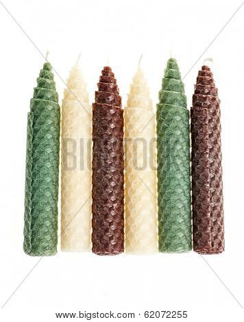 Colorful beeswax candles isolated on white background