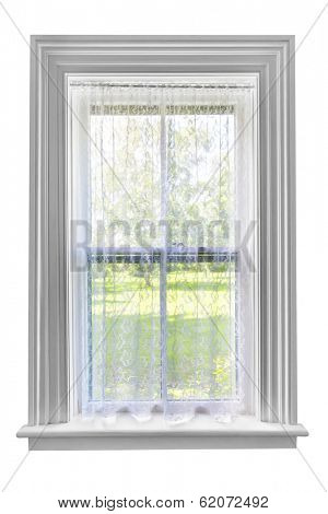 Window and sill with sheer lace curtains isolated on white background