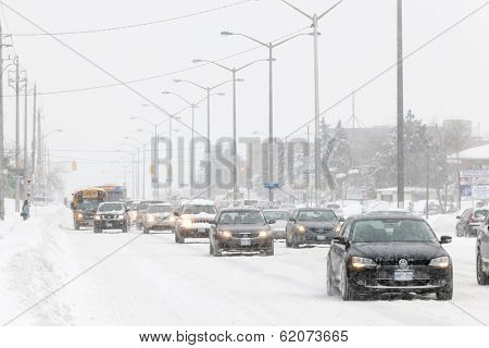 TORONTO, CANADA  FEBRUARY 5, 2014: Traffic on Kingston Road during winter snowstorm on Wednesday, February 5, 2014 in Toronto. Drivers cope with hazardous conditions during the 2014 polar vortex.