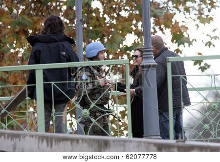 ESZTERGOM, HUNGARY - NOV 10: Angelina Jolie instructs an actor playing a United Nations peace keeper how to use a pistol on the set of In The Land Of Blood And Honey in Esztergom, Hungary, on Wednesday, November 10, 2010.