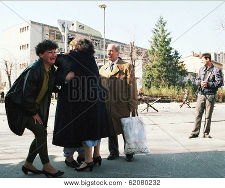 SARAJEVO, BOSNIA - APR 24: Women collapse in tears after being reunited with loved ones in front of a French UNPROFOR checkpoint in Sarajevo, Bosnia, on Sunday, April 24, 1994.