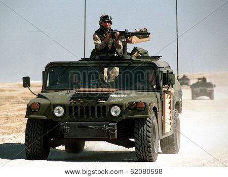 KUWAIT-IRAQ BORDER - FEBRUARY 19: United States Army troops patrol the Kuwaiti border with Iraq on Feb 19, 1998 on the Kuwait-Iraq border.