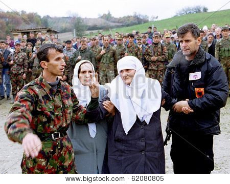 RETMILJE, KOSOVO, 12 NOVEMBER 1998 -  Kosovo Liberation Army (KLA) soldiers and family members attend a funeral for their commander, killed recently during fighting with Serb forces, in central Kosovo
