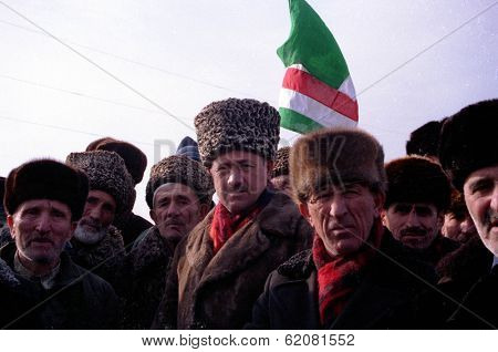 GUDERMES, CHECHNYA - NOVEMBER 29: Chechen elders from a nearby village  block a convoy of Russian army troops during the early stages of the invasion on November 29, 1994 in Gudermes, Chechnya