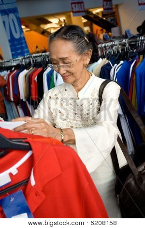 Senior Woman Shopping On Sale
