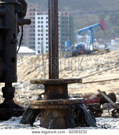 BAKU - AZERBAIJAN - FEB. 4: A drilling rig and a nodding donkey at a producing oil field near Baku, Azerbaijan, on Wednesday, February 4, 2009.