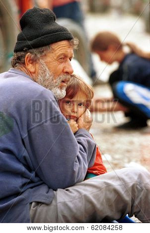 KUKES, ALBANIA, 18 APRIL 1999 --- Kosovar Albanian refugees take refuge at a makeshift camp just across the border in northern Albania. Tens of thousands of Albanians have fled Kosovo.