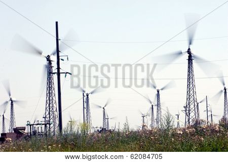 NOVOAZOVSK - JULY 13: Windmills generate energy at the Novoazovsk wind farm in Novoazovsk, Ukraine, on Thursday, July 13, 2006. The windmills generate 50 MW of power for local industry.