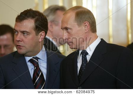 BRATISLAVA - FEBRUARY 25:  Russian president Vladimir Putin, right, speaks with Kremlin chief of staff Dmitry Medvedev in Bratislava, Slovakia, on February 25, 2005.