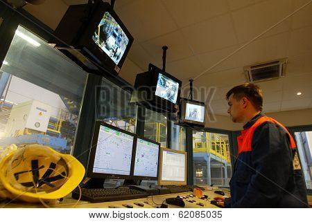 KOSICE - APRIL 25:  Workers in a computer controlled operation's center keep an eye on production at the cold rolling plant  of U.S. Steel Kosice, s.r.o in Kosice, Slovakia, on April 25, 2005.