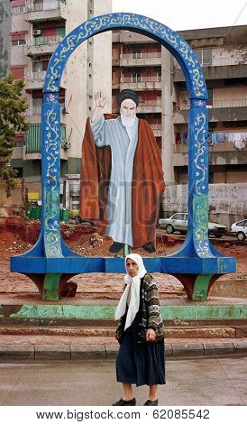 BEIRUT - MARCH 25:  A large portrait of the Ayatolla Khomeini watches over passersby in Herat,  a  pro-Hezbollah section of Beirut on March 25, 2000.