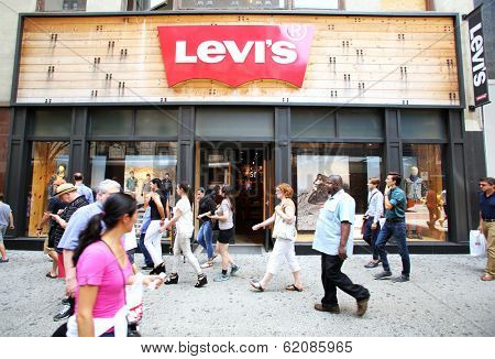 NEW YORK CITY - JULY 8: Shoppers walk past a Levi's retail clothing store in New York City, New York, on Monday, July 8, 2013. Levi Strauss & Co is a privately held American clothing company.