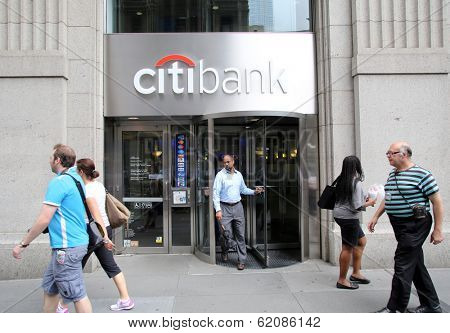 NEW YORK CITY - JULY 11: Pedestrians walk past a Citibank retail branch in lower Manhattan on Thursday, July 11, 2013.
