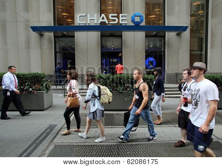 NEW YORK CITY - JULY 11: Pedestrians walk past a branch office of  Chase Bank in lower Manhattan on Thursday, July 11, 2013.  JPMorgan Chase & Co. is an American multinational bank.