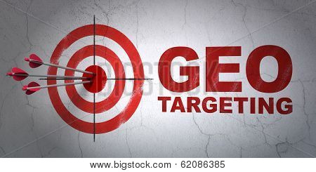 Business concept: target and Geo Targeting on wall background
