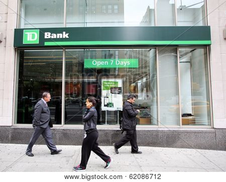 NEW YORK CITY - OCT 23 2013:  Pedestrians walk past a branch office of TD Bank, N.A.,  in Manhattan on Wednesday, October 23, 2013.