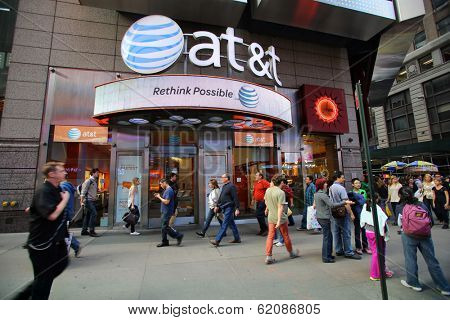 NEW YORK CITY - OCT 17:  Pedestrians walk past an AT&T Wireless Services, Inc.  retail outlet in Manhattan on Thursday, October 17, 2013.