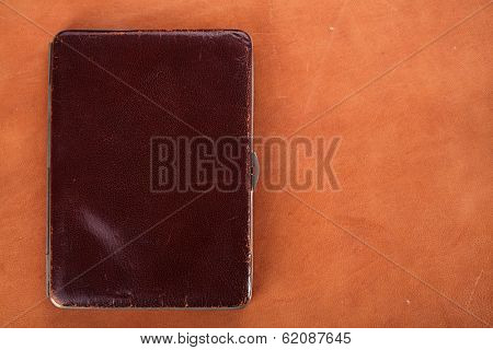 19th century old leather wallet on leather background, 1904 year