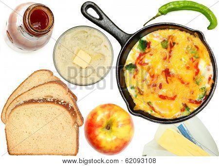 Breakfast over white, omelet, apple, egg, butter, bread, hot sauce, pepper.