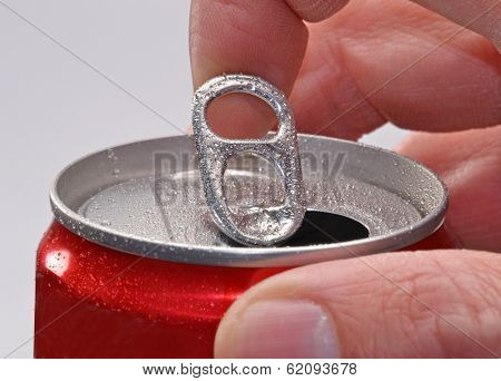Hand opening soda can.