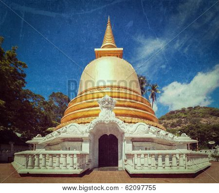 Vintage retro hipster style travel image of buddhist dagoba (stupa) close up  with grunge texture overlaidin Golden Temple, Dambulla, Sri Lanka