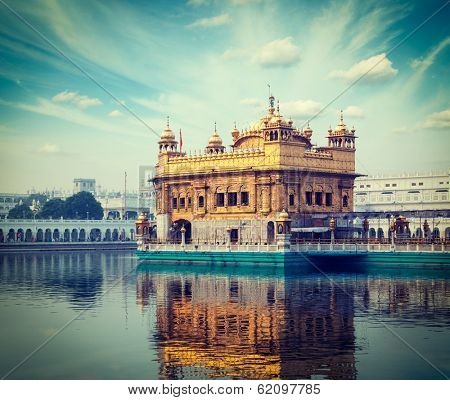 Vintage retro hipster style travel image of Sikh gurdwara Golden Temple (Harmandir Sahib). Amritsar, Punjab, India