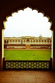 view of lawn through doorway at agra fort