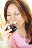 Mature woman drinking from a glass of red wine