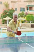 Elderly man playing ping pong