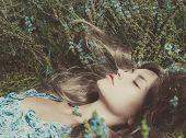 foto of nymphs  - Beautiful sensual lady lying on flower meadow - JPG