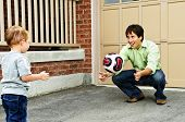 foto of bounce house  - Father teaching son to play soccer on driveway - JPG