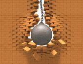 pic of wrecking  - Rusty wrecking ball destroying the red brick wall - JPG