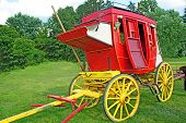 stock photo of stagecoach  - Antique red and yellow stage coach in the field - JPG