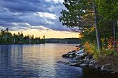 picture of breathtaking  - Dramatic sunset and pines at Lake of Two Rivers in Algonquin Park - JPG