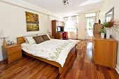 stock photo of master bedroom  - Bedroom interior with hardwood floor  - JPG