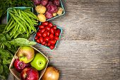 stock photo of wooden table  - Fresh farmers market fruit and vegetable from above with copy space - JPG
