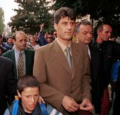 PRISTINA, KOSOVO, 17 JUNE 1999 - Hacim Thaci, center, nominal leader of the Kosvar Albanians, walks