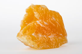stock photo of calcite  - Yellow and orange calcite, found in Mexico on white background - a carbonate mineral and polymorph of calcium carbonate, CaCO3. ** Note: Visible grain at 100%, best at smaller sizes - JPG