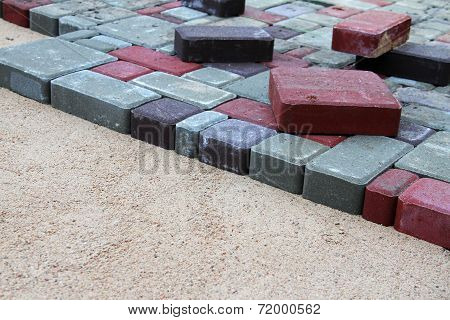 Gravel And Colorful Pavement Bricks
