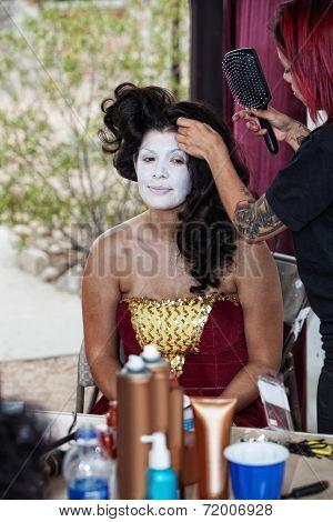 Makeup Artist Working On Cirque Performer