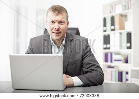 Businessman Listening Intently To The Viewer