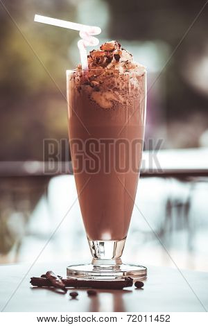 Glass of chocolate milkshake with whipped cream